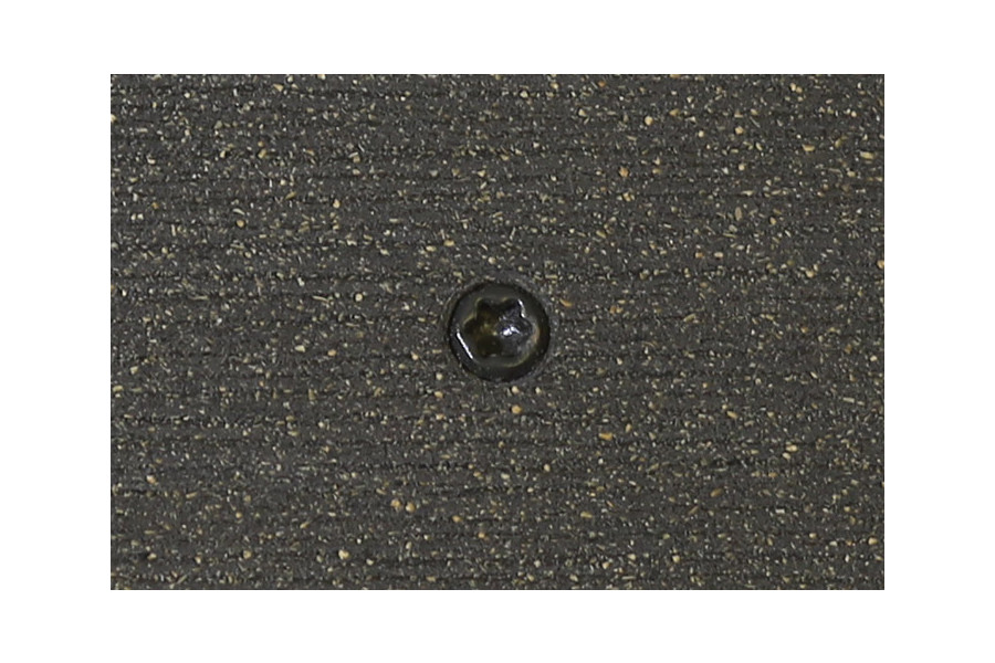 Charcoal composite decking board with Charcoal colour match screw fixed to the middle of the board.