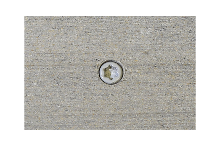 Luna composite decking board with Luna colour match screw fixed to the middle of the board.