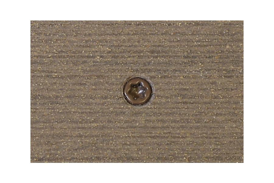Traditional composite decking board with Traditional colour match screw fixed to the middle of the board.