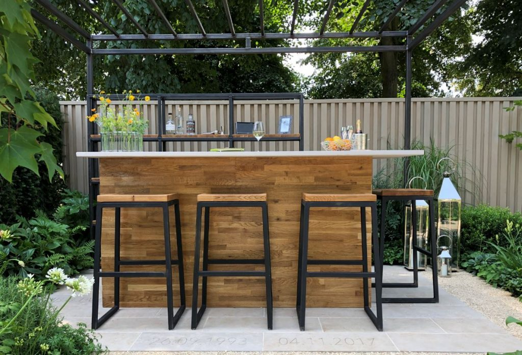 The Landform Garden Bar featuring engraved elements