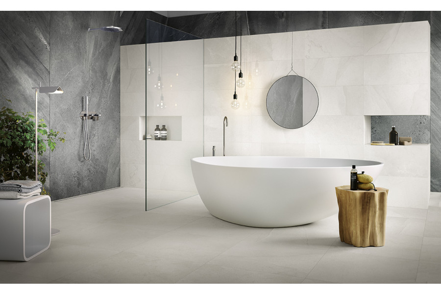 These grey porcelain shower tiles are the perfect complement to the rest of the white porcelain bathroom.