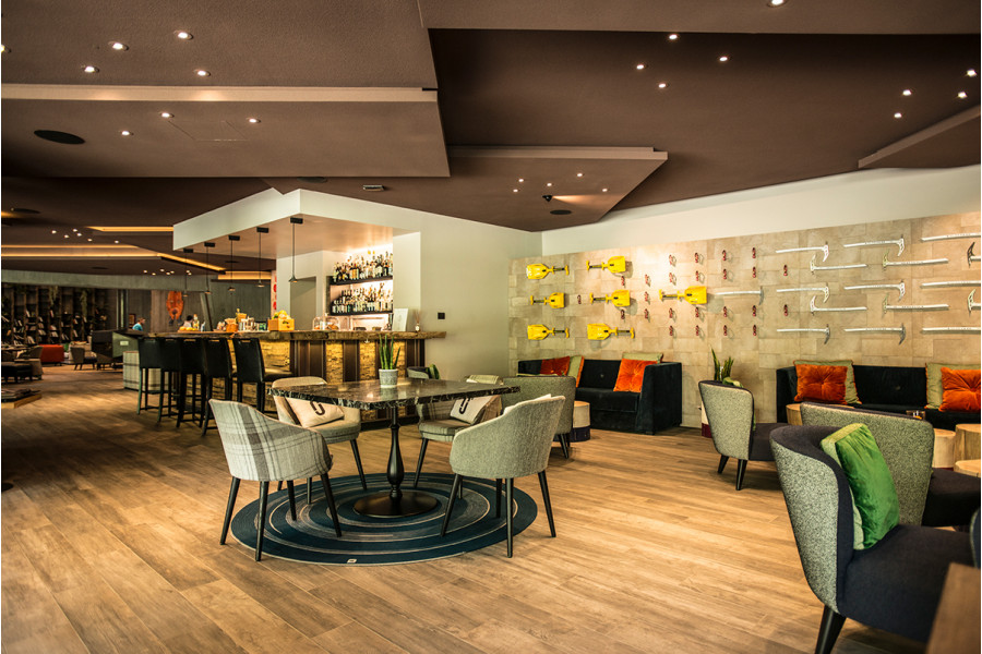 These wood-effect tiles make the perfect relaxing space inside this restaurant.