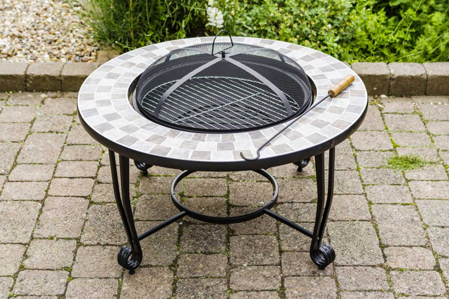 A charcoal firepit is a stylish addition to the garden as well as producing plenty of heat.