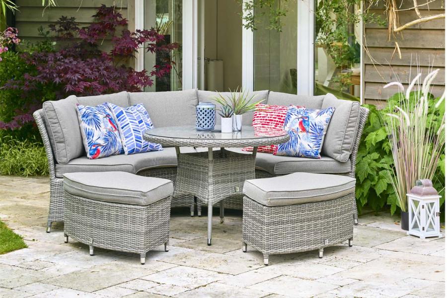 Enjoy evenings in the garden on this circular rattan dining set.
