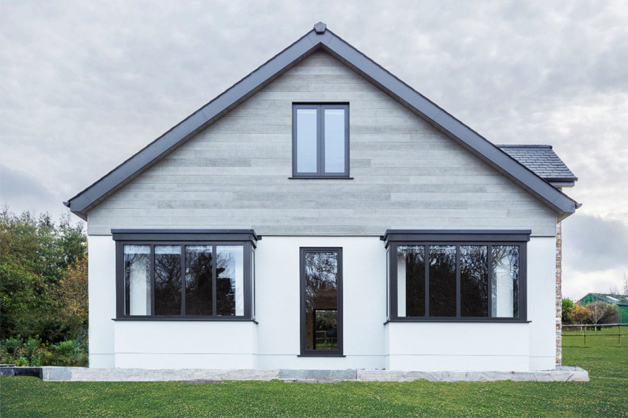 The cool grey tones of the Millboard Cladding give this home a Scandinavian contemporary feel.