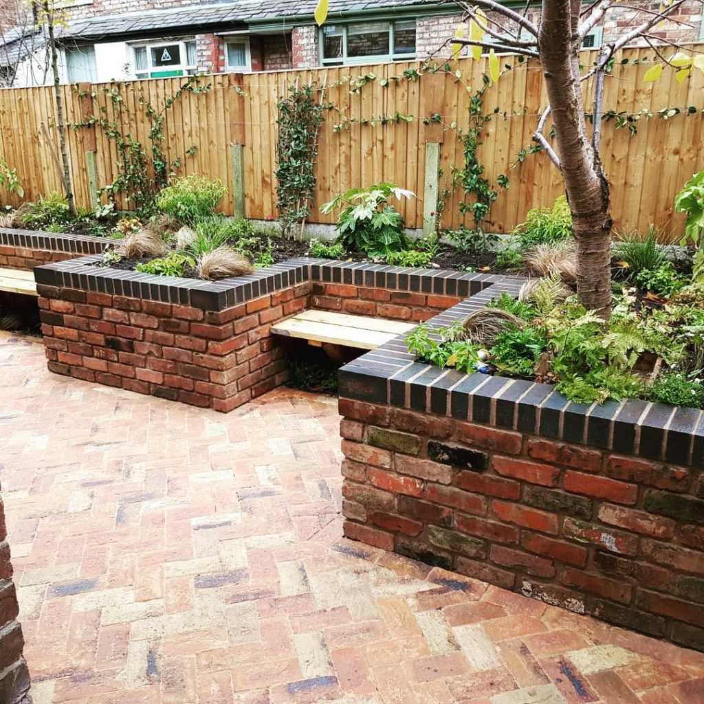 Facing bricks add a classic finish around the garden when matched with complementary paving.