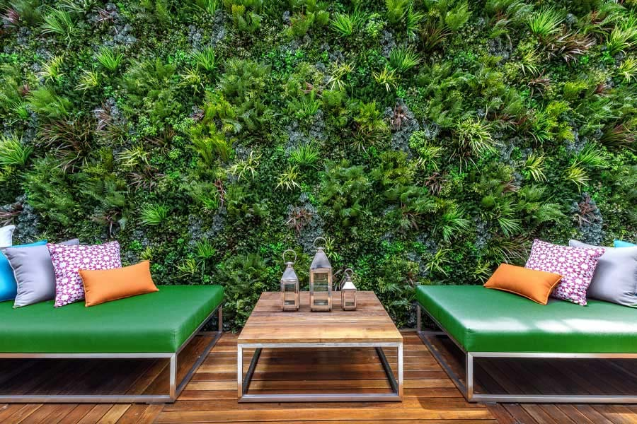 Artificial green walls will transform a dull space to a bright and inviting space.