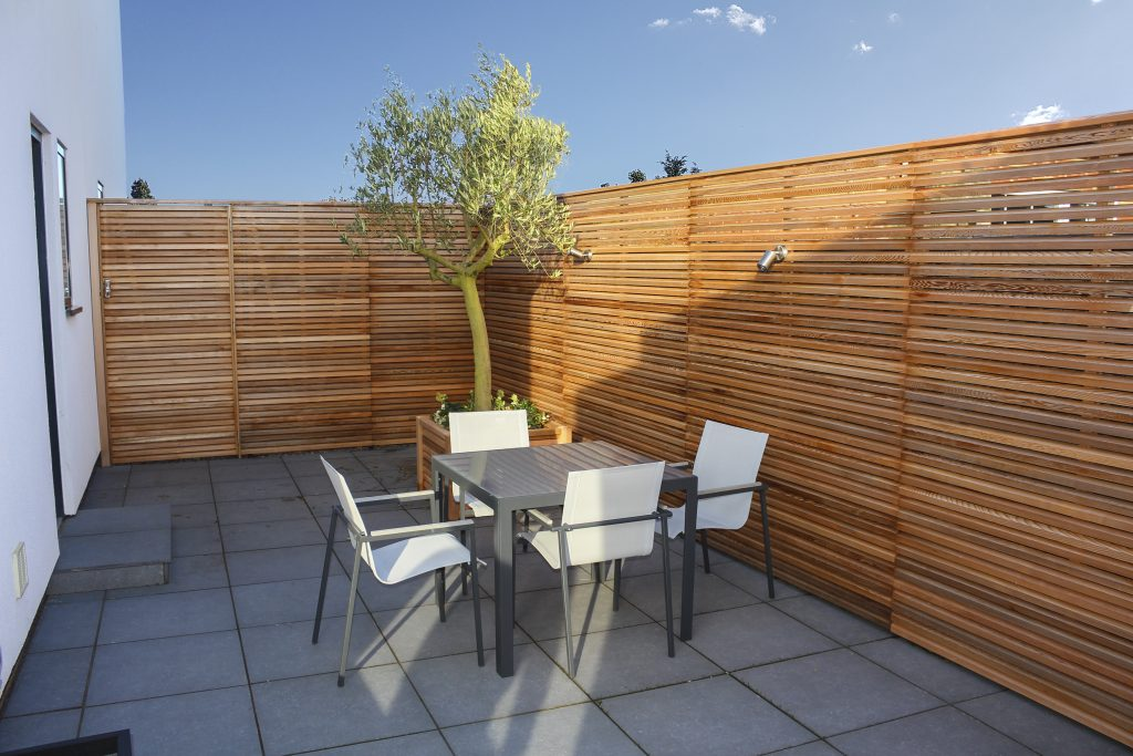 Red cedar fencing will bring instant luxury to the garden.