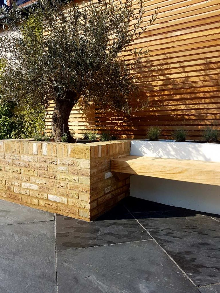 Use facing bricks around the garden to add a classic touch.