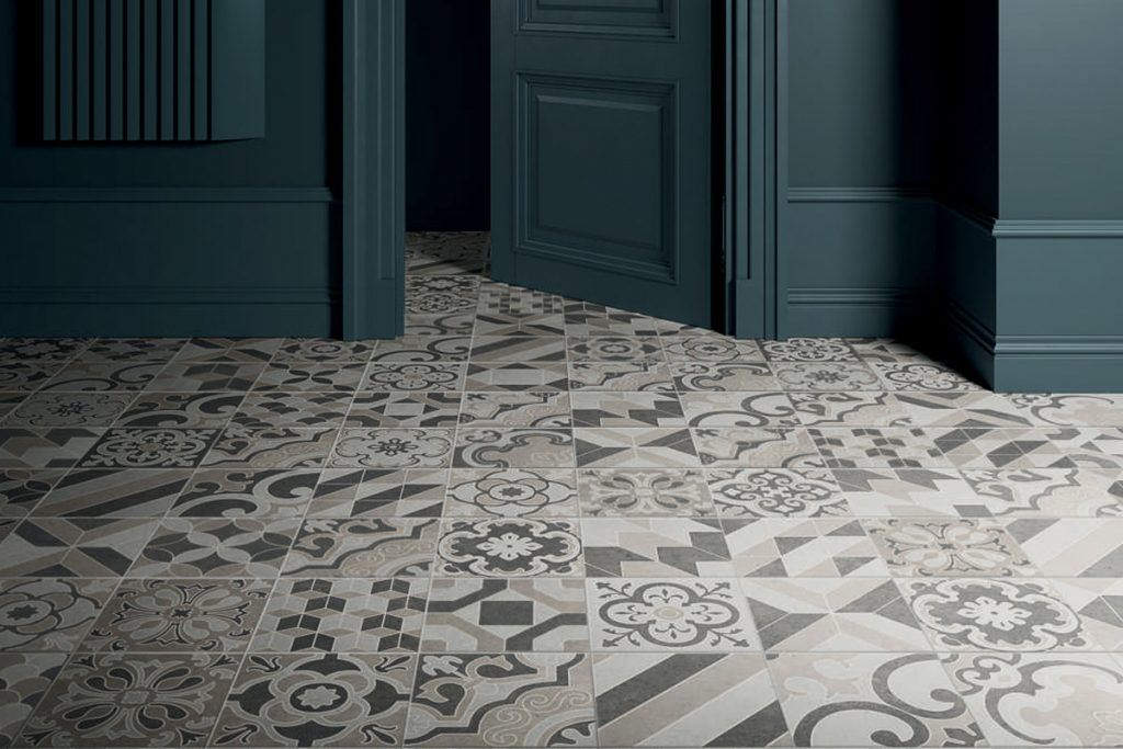 Use patterned tiles on the walls to create bold flooring.