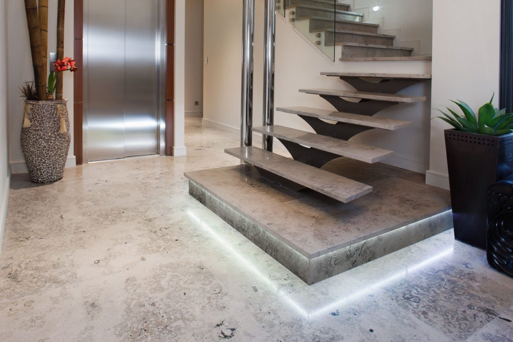 Make a bold statement around the home with jura grey limestone tiles.