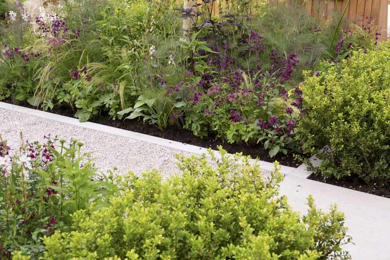Viking Frilufsliv Garden by Will Williams, built by Burnham Landscapes, Hampton Court Palace Garden Festival 2021, Jura Grey Limestone paths with wildlife friendly planting.