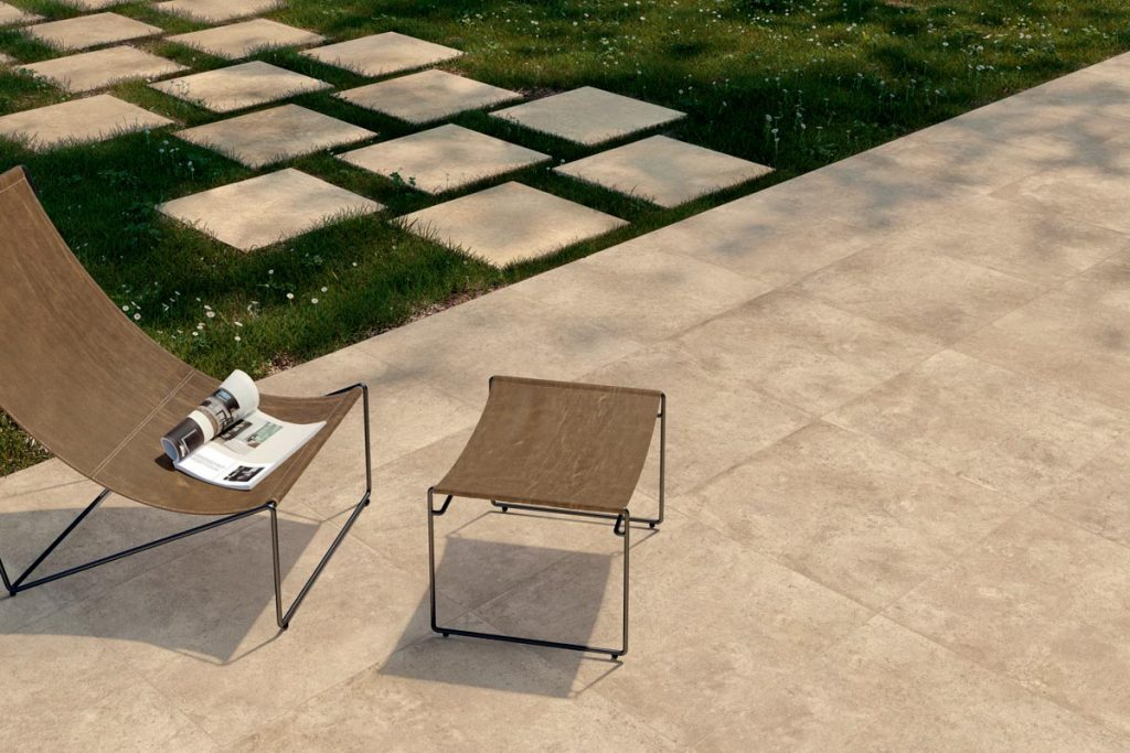 Corda 800x800 Porcelain Paving with matching stepping stones is paired with a simple chair and stool.