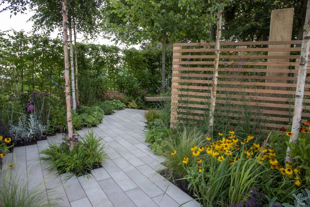 Cream Porcelain Planks make the perfect complement to the planting in this garden. Creating a safe space to relax and talk.