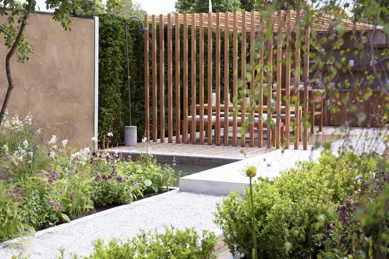Will Williams' Viking Friluftsliv Garden, Hampton Court Palace Garden Festival 2021, jura grey limestone and plunge pool. Built by Burnham Landscaping.