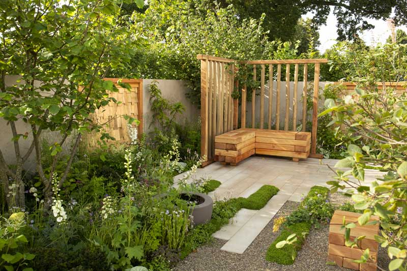 Plank paving makes a statement in this garden at RHS Hampton Court Palace Flower Show Festival.