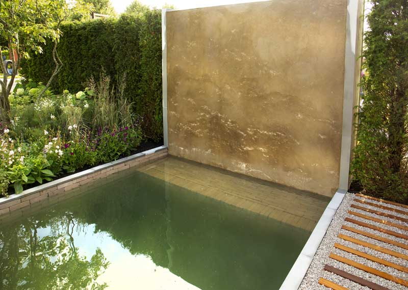 Clay pavers and limestone make a stunning backdrop in this water feature.