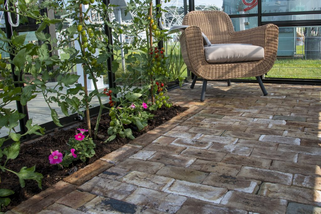 London Mixture clay pavers have a beautiful classic feel that looks right at home in the charming greenhouse filled with tomato plants.