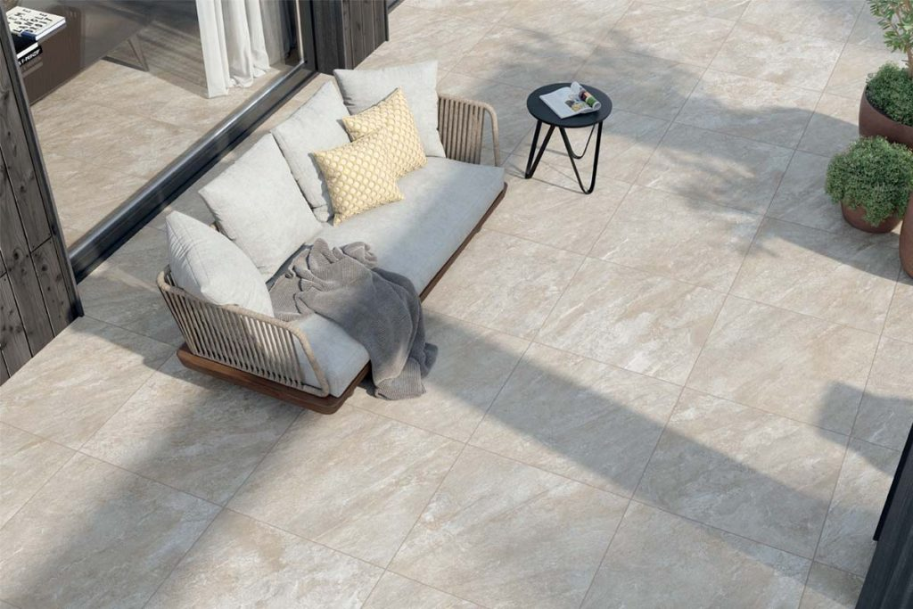 A simple but impressive design using Nest 800x800 Porcelain Paving paired with a complementary cream outdoor sofa.