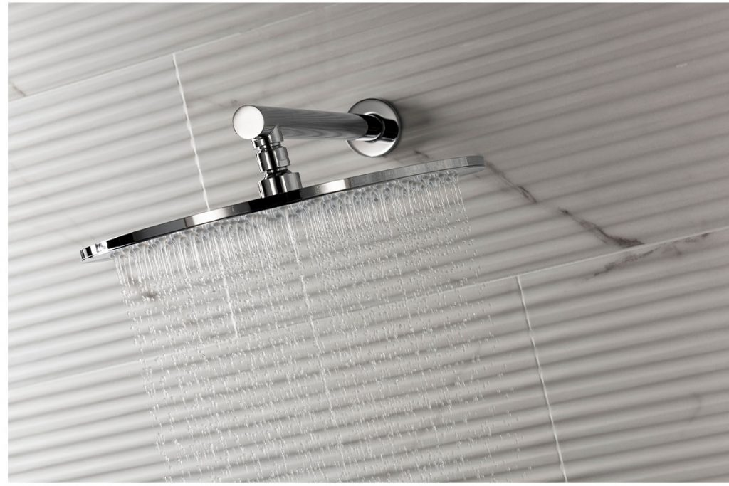Our marble effect tiles are used behind this shower head.