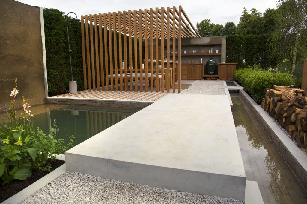Large slabs of Jura Beige Limestone create a bridge over a waterfall and plunge pool feature.