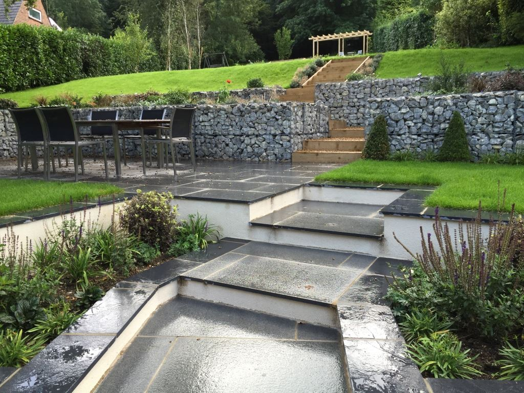 Blue Grey Granite paving, Black limestone coping, from London Stone