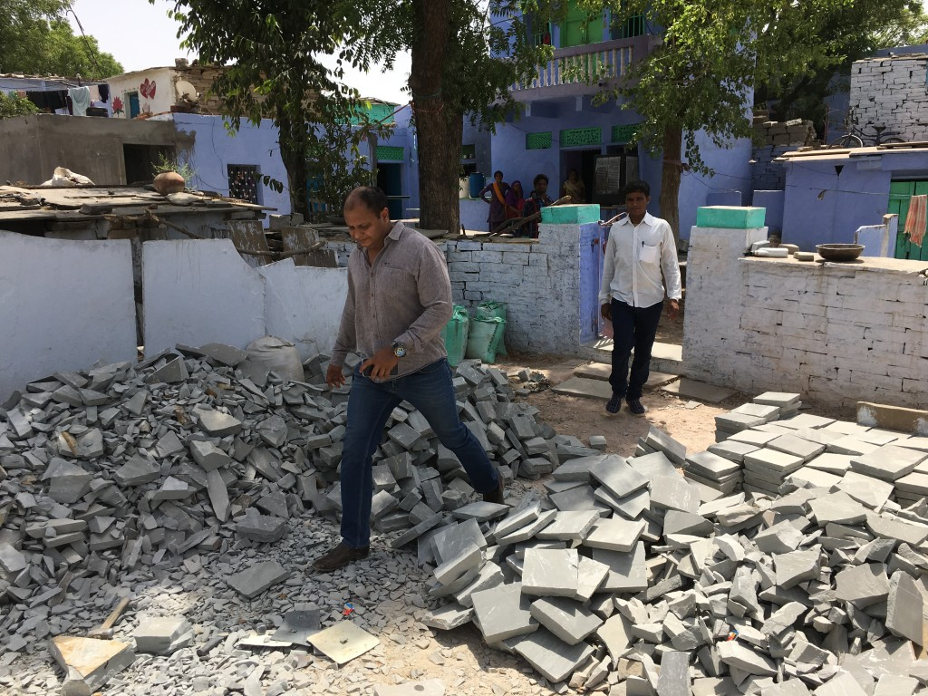 Waste stone is dropped off at houses to be worked into cobbles by families