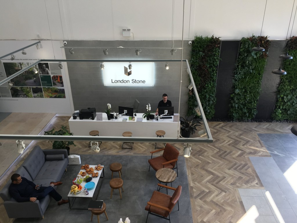North London Showroom front desk, Green Living Wall and refreshment and seating area